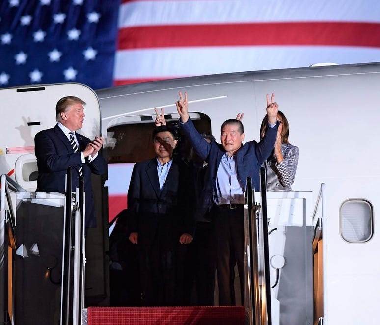 President Trump applauds American prisoners freed by North Korea, at Joint Base Andrews in Maryland on May 10.