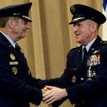 "The change of command is an official ceremony where the command flag is exchanged, representing the responsibility and authority being transferred from one officer to another. At Barksdale Air Force Base Tuesday, Lt. Gen. Stephen W. ""Seve"" Wilson (center) hands the Air Force Global Strike Command flag over to Air Force Chief of Staff Gen. Mark Welsh as Gen. Robin Rand (right) waits to receive it."
