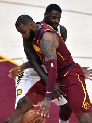 Nov 1, 2017; Cleveland, OH, USA; Indiana Pacers guard Lance Stephenson (1) defends Cleveland Cavaliers forward LeBron James (23) in the second quarter at Quicken Loans Arena. Referees ruled Stephenson committed a flagrant foul type 1 on the play. Mandatory Credit: David Richard-USA TODAY Sports