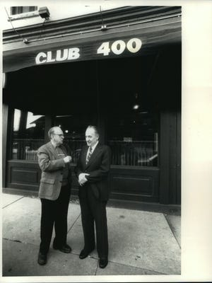 Guitar innovator Les Paul (left) and his formed drummer, Cullen Casey, stopped to reminisce in front of Waukesha's Club 400, where Paul played with Mary Ford for the first time.