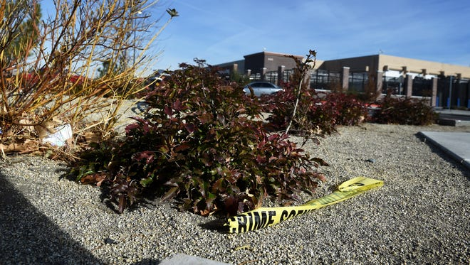 A piece of police crime scene yellow tape is seen near the entrance to the Walmart on E. Second St. in Reno. A man was shot and killed in front of the store on Nov. 24, 2016.