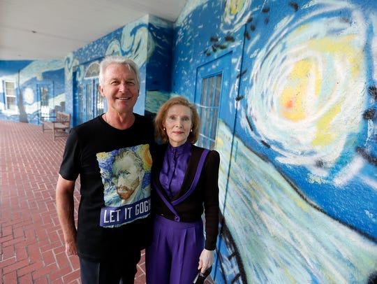 Lubomir Jastrzebski and Nancy Nemhauser stand by a section of a mural at their home in Wednesday, July 18, 2018, in Mount Dora, Fla.