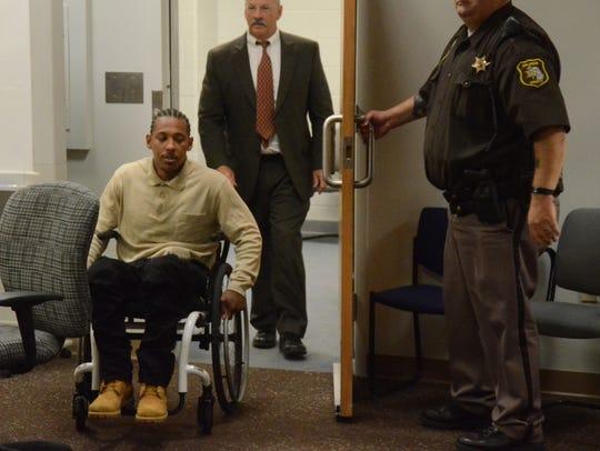 Paul Tyler and his attorney, John Sullivan enter the