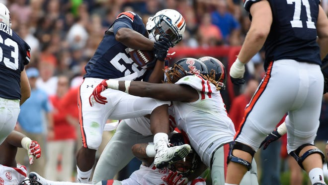 Auburn running back Jovon Robinson (29) is brought down by Ole Miss defensive end Fadol Brown (6) during the second quarter at Jordan Hare Stadium. The Tigers are wary of the Rebels' defense this season.