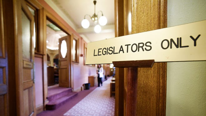 """A sign reading """"Legislators Only"""" stands in a hallway near the senate chambers in the South Dakota State Capitol on Jan. 9, 2018 in Pierre, S.D."""