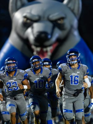 Chandler players take the field before their high school football game against Mountain Pointe on Friday, Sept. 8, 2017, at Chandler High School in Chandler, Ariz.