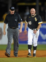 Southern Miss head coach Scott Berry yells to the umpires during the Hattiesburg Regional game against Mississippi State on Monday at Pete Taylor Park.