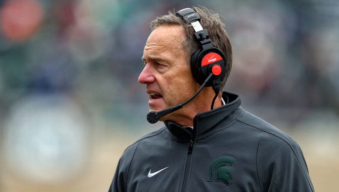 Michigan State Spartans head coach Mark Dantonio stands on the sidelines during the 2nd half of a game against the Rutgers Scarlet Knights at Spartan Stadium.
