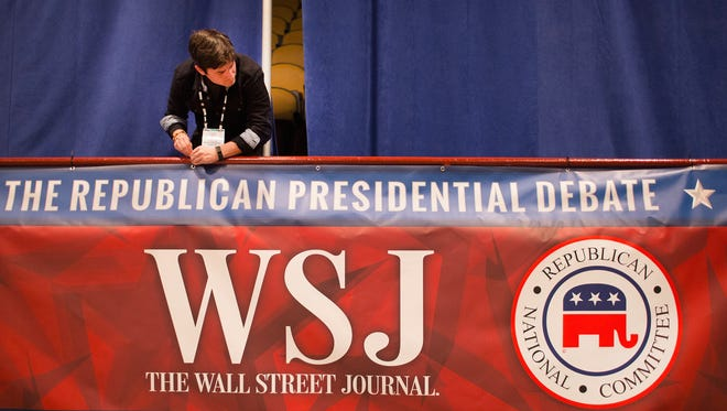 A worker sets up for the Nov. 10 GOP debate in Milwaukee, Wisconsin.