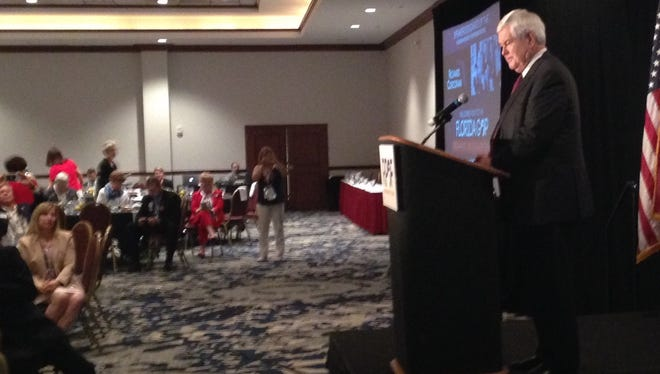 Former U.S. House Speaker Newt Gingrich talks to Florida's delegation to the RNC Thursday.