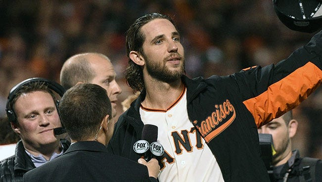 Giants pitcher Madison Bumgarner waves to the crowd after the Game 5 win in the World Series.