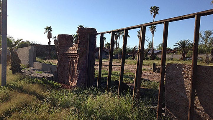 A reader sent in this eyesore: a fence made of slump