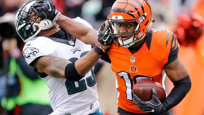 Cincinnati Bengals wide receiver Cody Core (16) stiff-arms Philadelphia Eagles free safety Rodney McLeod (23) as he runs for the end zone on a deep catch in the first quarter of the NFL Week 13 game between the Cincinnati Bengals and the Philadelphia Eagles at Paul Brown Stadium in downtown Cincinnati on Sunday, Dec. 4, 2016.
