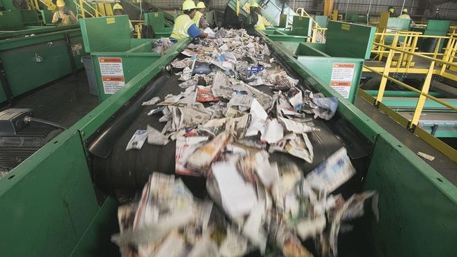 A line where newspaper is separated on its way to be bundled. Resource, Recovery and Recycling Authority of Southwest Oakland County in Southfield, Michigan on September 15, 2016. (The Detroit News/ Daniel Mears)