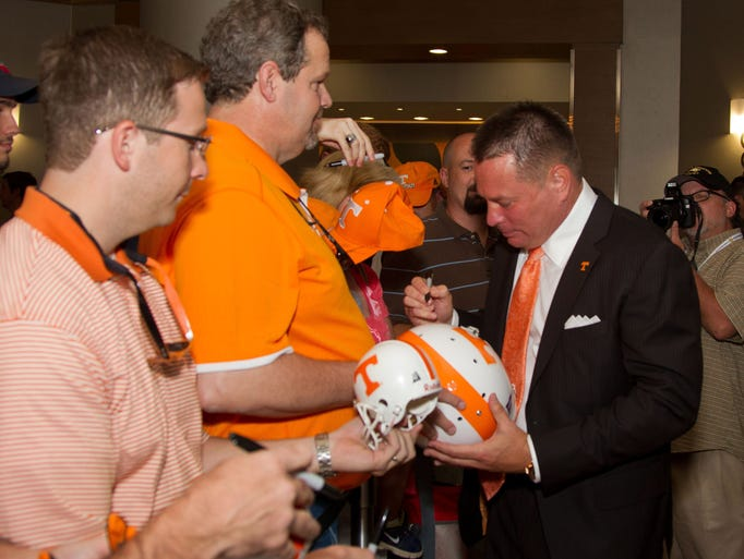 Tennessee coach Butch Jones signs autographs for fans at SEC Media Days on Tuesday.