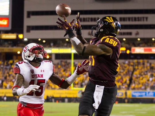 ASU wide receiver Jaelen Strong makes a touchdown catch over Utah defensive back Dominique Hatfield during the second quarter of the college football game at Sun Devil Stadium in Tempe on Saturday, Nov. 1, 2014.