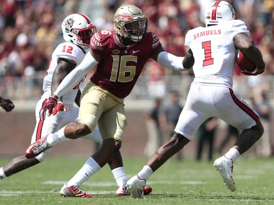 FSU's Jacob Pugh chases after NC State's Jaylen Samuels