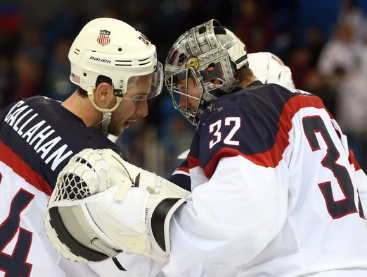 USA goalie Jonathan Quick (32) celebrates with Ryan Callahan (24) after defeating Czech Republic in the men's ice hockey quarterfinals Wednesday in Sochi.