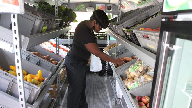 Customers can buy fresh produce from area farmers from Foodlink's Curbside Market.