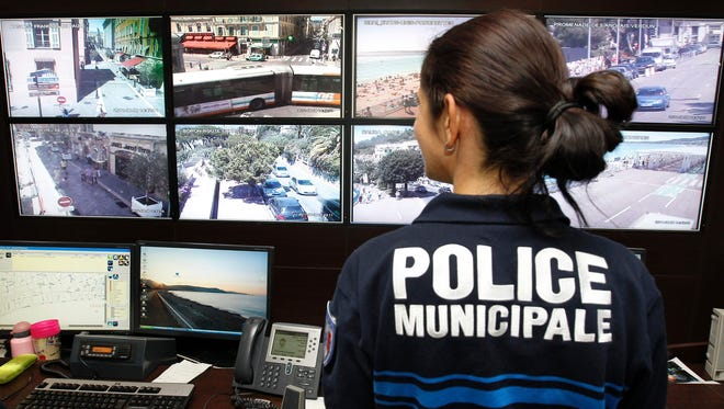 Police officers and CSU operators, working on a video projection system, in the Urban Supervisory Control Centre (CSU) in Nice. France.
