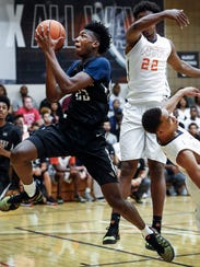 Team Penny forward James Wiseman (left) drives for