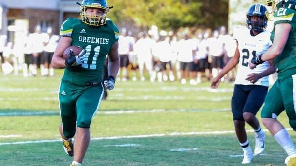 Christ School's Cade Mintz breaks open for a big gain during a game last season at Christ School.