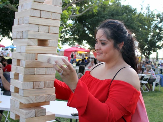 Magali Gomez enjoyed a game of Giant Jenga on Saturday