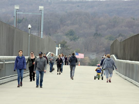 People walk on the Walkway Over the Hudson in February 2018.