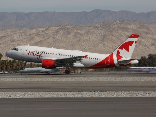 An Air Canada flight lands at the Palm Springs International