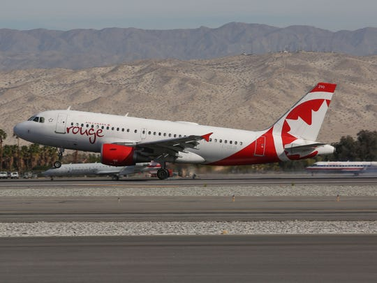 An Air Canada flight lands at the Palm Springs International Airport, December 14, 2016.