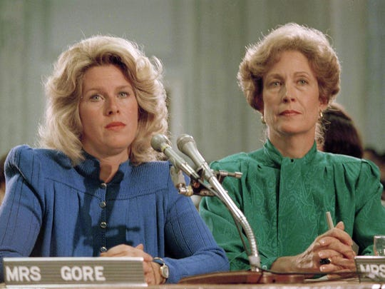 Tipper Gore, left, and Susan Baker, wife of then-Secretary of State James A. Baker, appear in 1985 at a Parents Music Resource Center committee hearing in Washington, D.C. The PMRC campaigned to get the music industry to put warning labels on content with explicit lyrics.