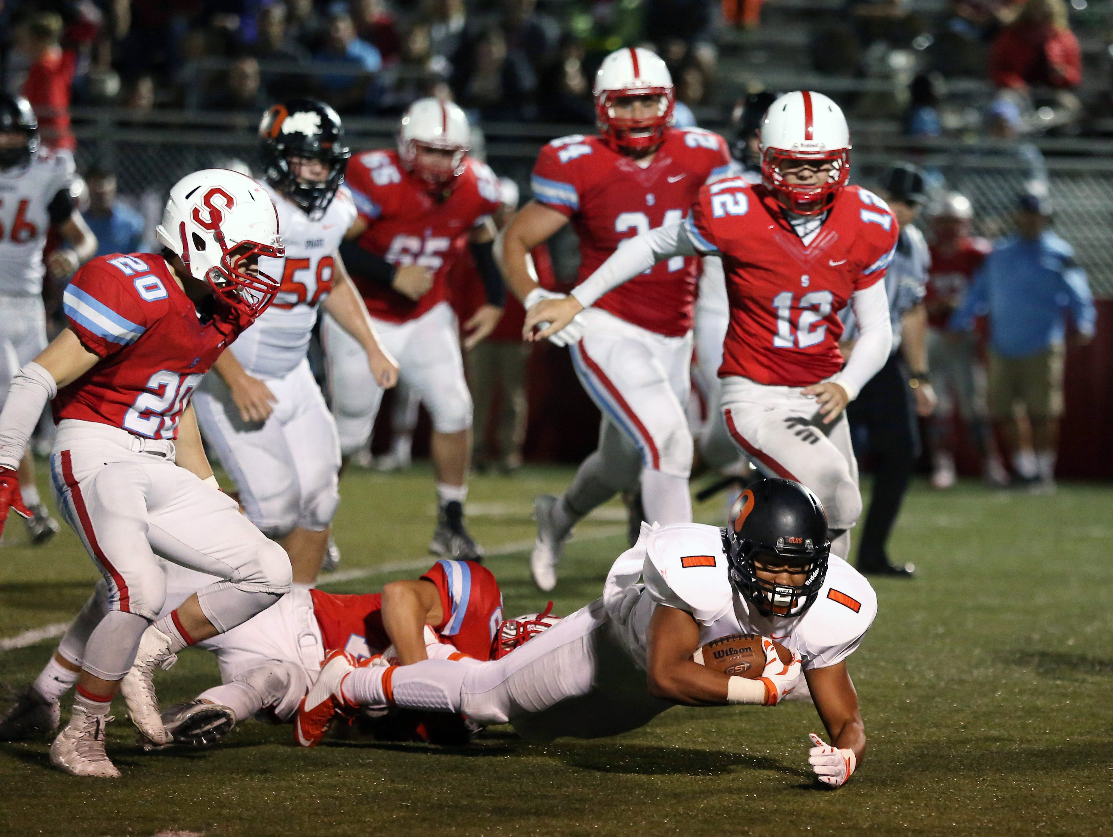 Sprague's Noah Mellen runs the ball as the Olys defeat South Salem 48-7 in a Greater Valley Conference game on Friday, Sept. 2, 2016, at South Salem.