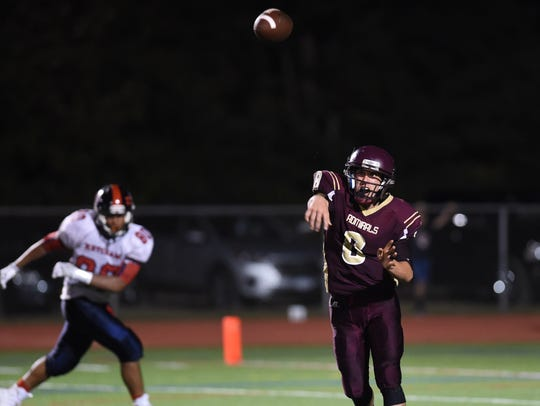 Austin Heck, pictured throwing the football while playing for Arlington's team against Roy C. Ketcham in September 2016, was diagnosed with cancer recently.