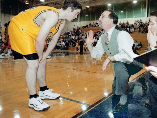 Delone Catholic coach Darrell Wildasin talks with Mike