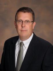 Dr. Tyler K. Huggins