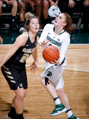 Freshman point guard Taryn McCutcheon, right, is among many new faces on the court for Michigan State this season.
