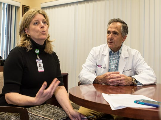 Kathleen H. Seneca, left, and Dr. Ronald Nahass, president of ID Care, an infectious disease practice in Hillsborough, talk about Dr. Nahass' recently presented conclusions drawn in a study on the incidence of Hepatitis C in suburban drug users in New Jersey.
