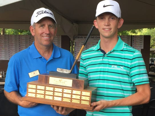 Jacob Bridgeman of Inman, right, with tournament director