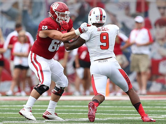 Indiana Hoosiers offensive lineman Brandon Knight (62) fights off Ball State Cardinals defensive end Reggie McGee (9) during first quarter action at Indiana University's Memorial Stadium, Bloomington, Ind., Saturday, September 10, 2016.