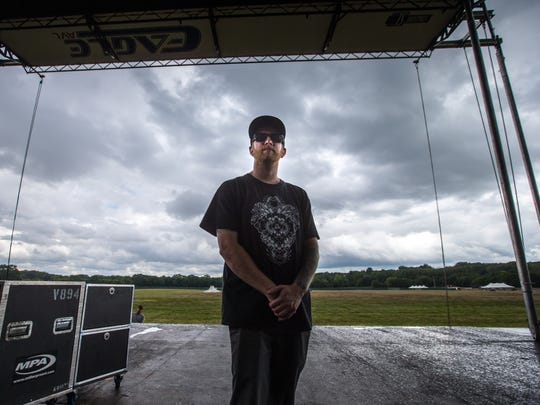 Dan Green, director of 515 Alive music festival, stands for a portrait on the stage at Water Works Park Wednesday, Aug. 16, 2017.