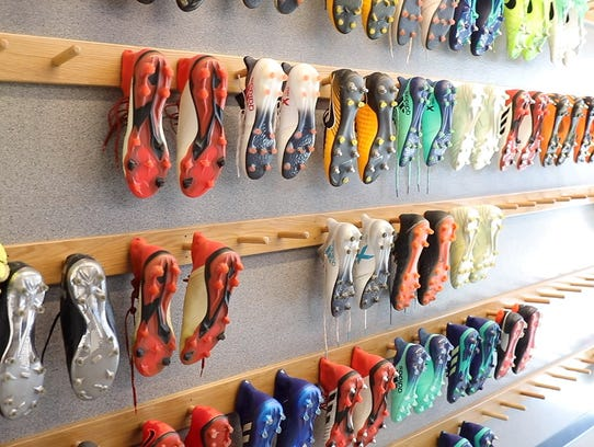 Players' cleats line the wall at the New York City Football Club new training facility in Orangeburg on Tuesday, April 24, 2018.