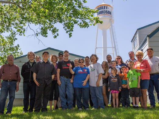 Ryder, N.D., residents gather in front of the town's