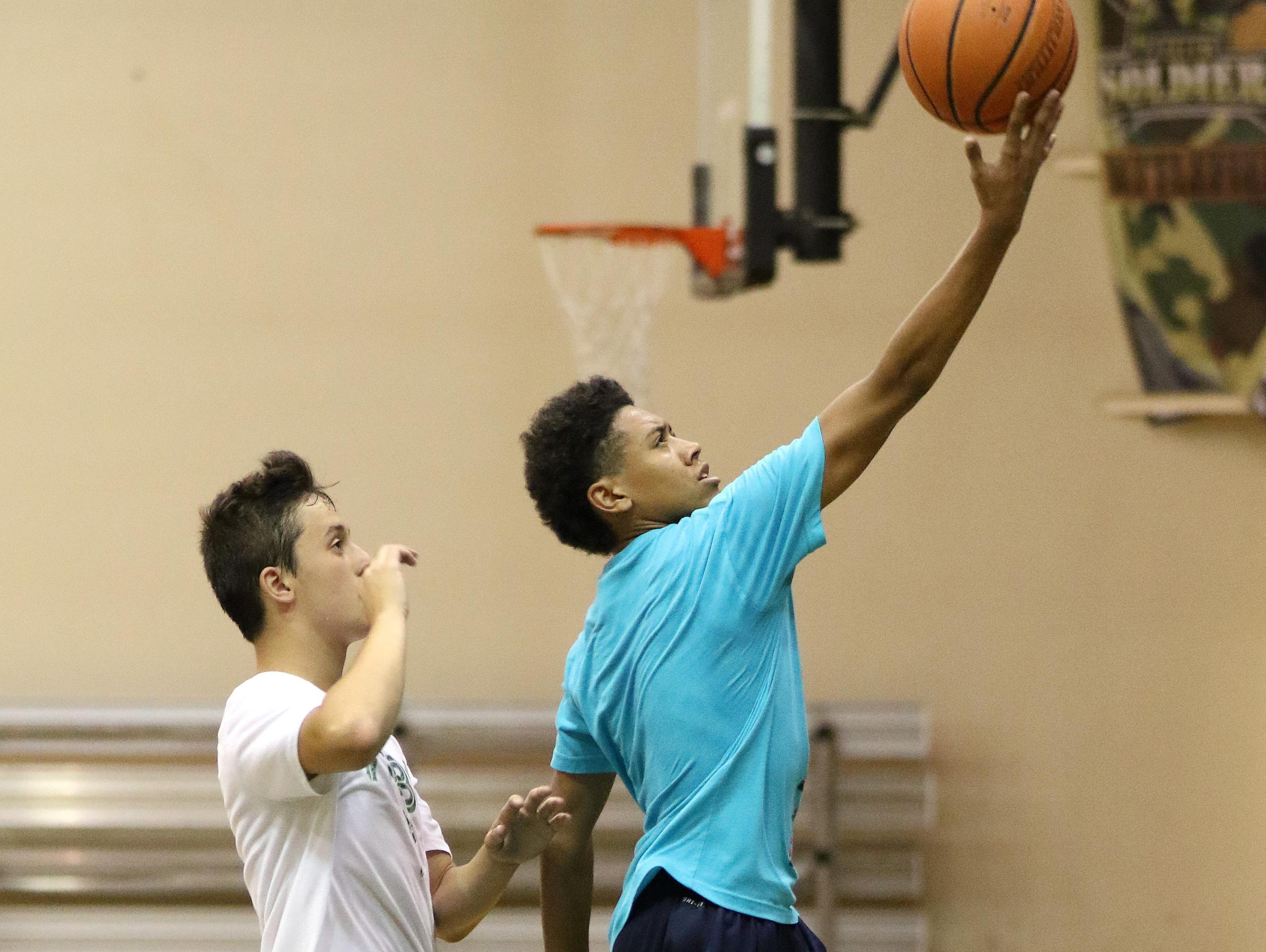 Jaden Nielsen, right, who will be a freshman at South Salem High School in the fall, practices on Tuesday, July 7, 2015, at The Hoop in Salem. Nielsen has been invited to participate in a prestigious basketball camp run by NBA All-Star Chris Paul.
