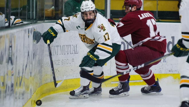 Vermont forward Craig Puffer (17) plays the puck during the men's hockey game between the UMass Minutemen and the Vermont Catamounts at Gutterson Fieldhouse on Friday night January 12, 2018 in Burlington.