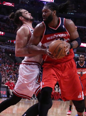 Wizards big man Nene backs down Bulls center Joakim Noah during a Game 1 victory Sunday.