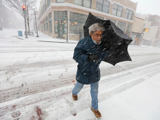 Manny Duarte is caught in the snow storm as he walks