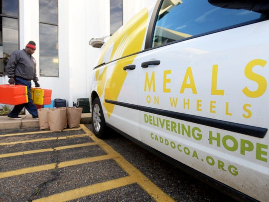 Terry Moore gets the food ready for delivery for the Meals on Wheels program Thursday morning in Shreveport.