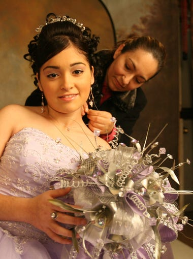 November 2007: Irene Guzman helps her daughter, Janet Guzman, 15, with a few finishing touches before a portrait sitting for her upcoming quinceañera at the Fred Mora Portrait Studio, 7020 Michigan Ave. Today, the portrait studio is boarded up. Janet Guzman graduated from U-M Dearborn and is engaged to be married with plans to move back into the the neighborhood.