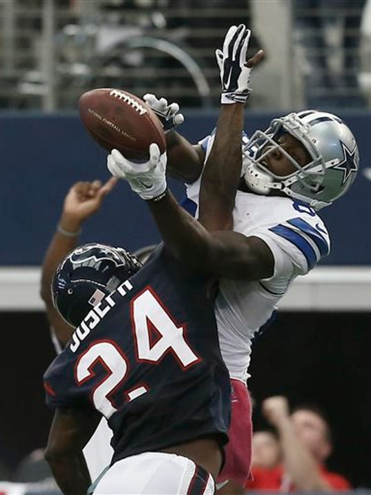 FILE  - In this Oct. 5, 2014, file photo, Dallas Cowboys wide receiver Dez Bryant (88) grabs a pass over Houston Texans' Johnathan Joseph (24) in overtime of an NFL football game in Arlington, Texas.