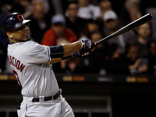 Cleveland Indians' Edwin Encarnacion hits a single against the Chicago White Sox during the sixth inning of a baseball game Thursday, Sept. 7, 2017, in Chicago. (AP Photo/Nam Y. Huh)